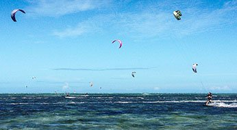 Kite surfers at Ilot Maitre, one of the best beaches in New Caledonia.