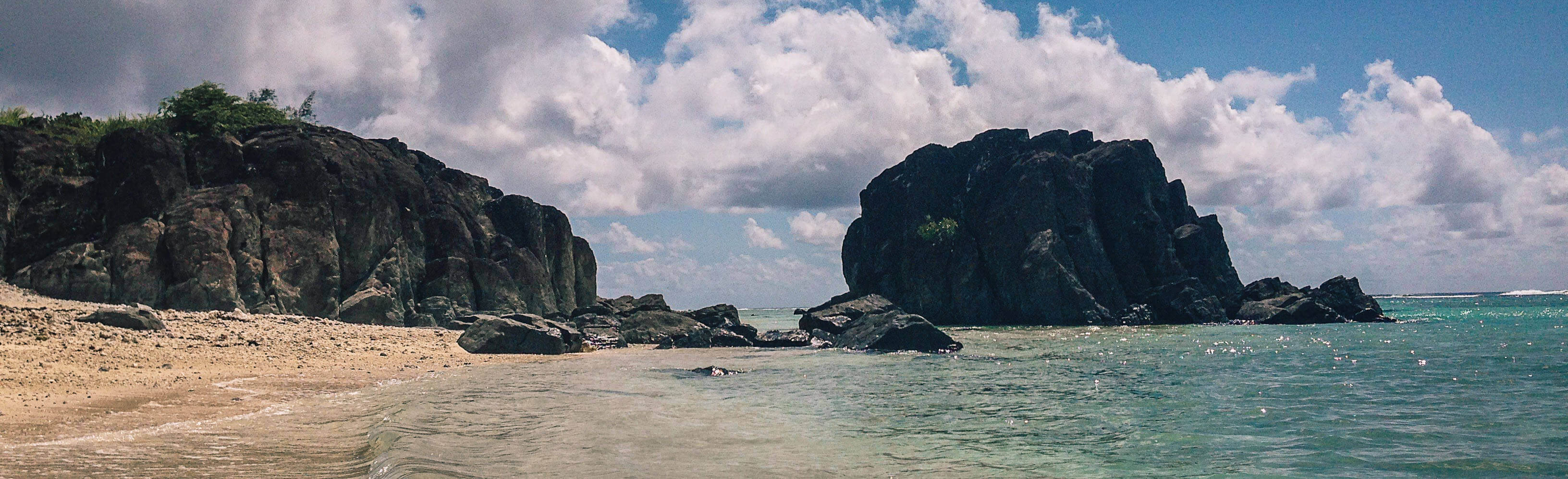 Black Rock Beach in Rarotonga packing guide.
